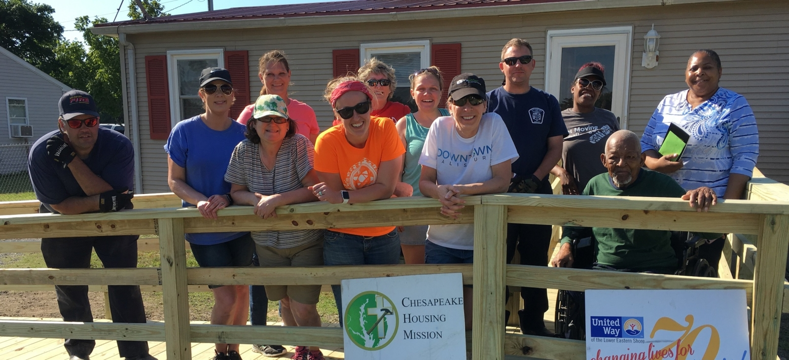 Volunteers help a neighbor by building a wheelchair ramp