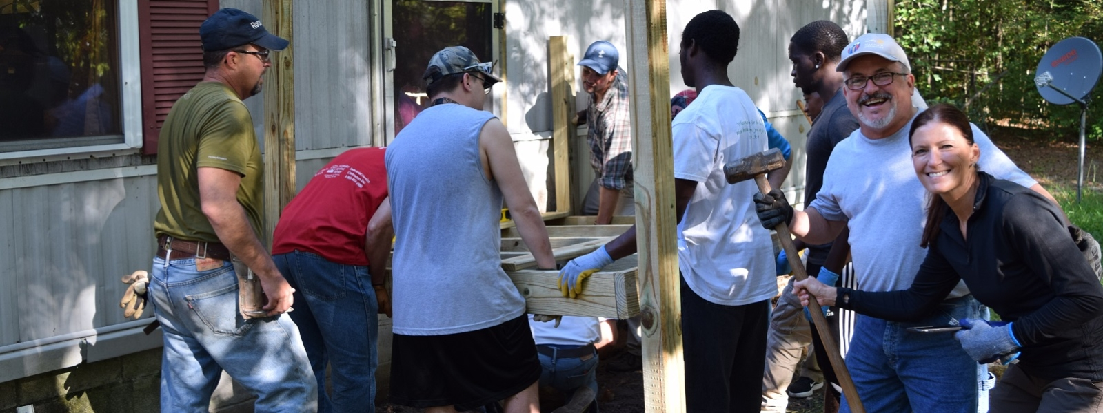 Volunteers work on a project for Chesapeake Housing Mission
