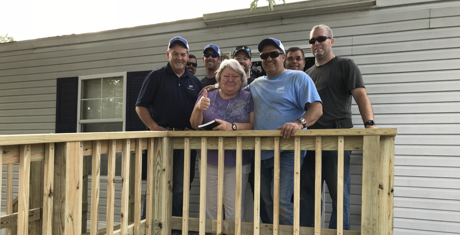 Volunteers give a day to help a neighbor in need.